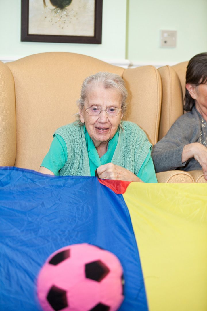 Resident at our care home in Surrey enjoying Activities
