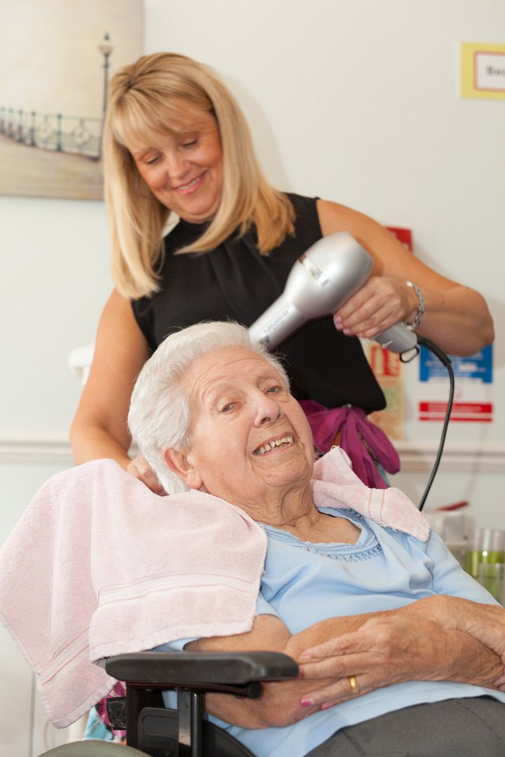 Care Home resident enjoying having her hair done at our hairdresser
