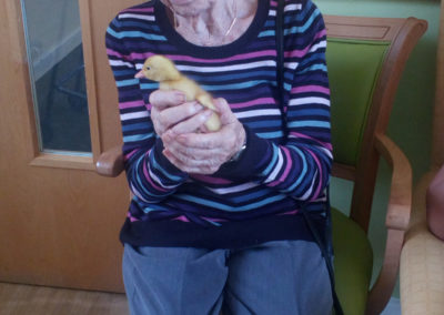 Female resident holding a duckling
