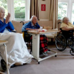 A group of seated residents enjoying live music