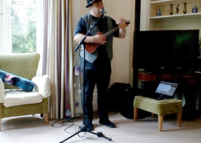 Live musician performing a song with a ukulele
