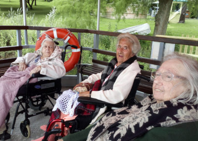 A group of seated residents enjoying a ferry ride