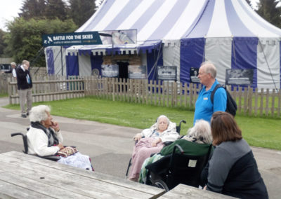 A group of residents outside a World War II exhibition marquee
