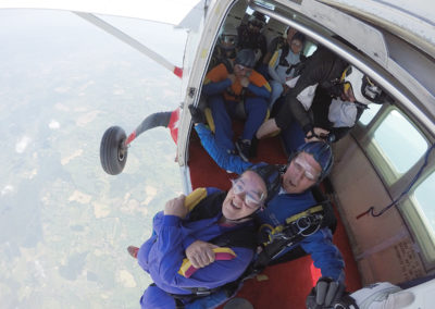 Annette and her instructor get ready to jump from a plane