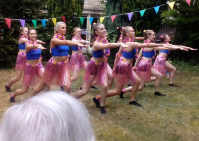 A group of girl dancers from girls from the Hilton Dance Academy performing at Loose Valley Care Home