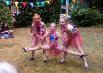 Three girls from the Hilton Dance Academy performing at Loose Valley Care Home