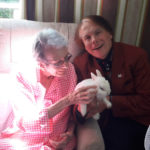 Loose Valley Care Home resident with entertainer The Magic Man and his rabbit Houdini