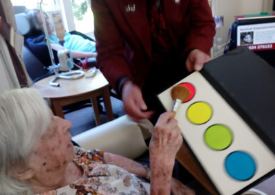 Magician Terry Knight performs a coloured paint trick at Loose Valley Care Home