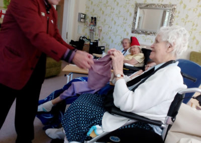 Magician Terry Knight performs a close-up magic to a resident at Loose Valley Care Home