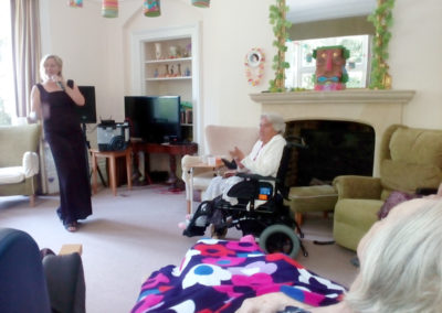 Female singer performing for Loose Valley Care Home residents