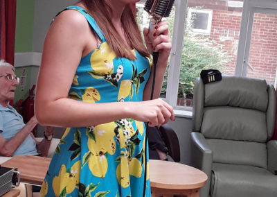 Professional singer Miss Holiday Swing entertains residents at Abbotsleigh Care Home