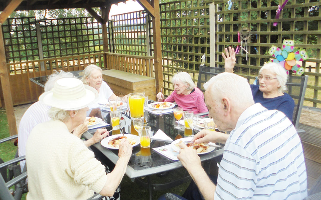 Sunday lunching in the sun at The Old Downs Residential Care Home