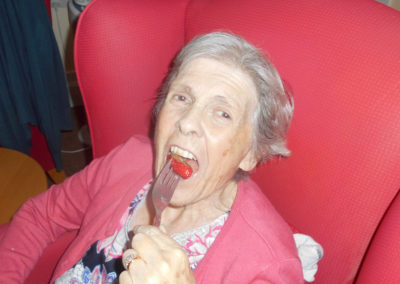 Woodstock lady resident posing for the camera about to eat a chocolate covered strawberry