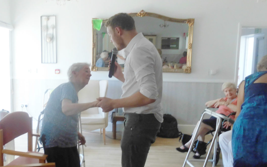 Curtis Skinner sings for residents at Woodstock Residential Care Home