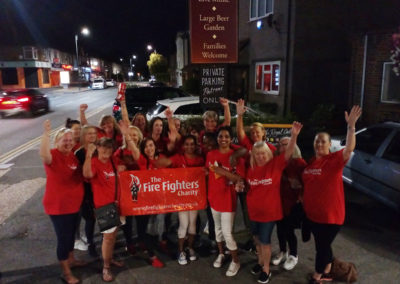 Meyer House Care Home stood outside the pub having finished their annual sponsored charity walk for The Fire Fighters Charity