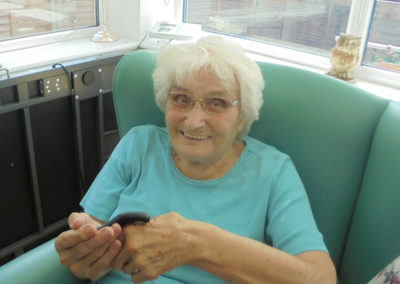 One of the ladies at The Old Downs Residential Care Home holding a centipede from Zoolab