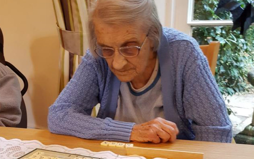 Lady resident at Loose Valley Care Home enjoying a game of scrabble