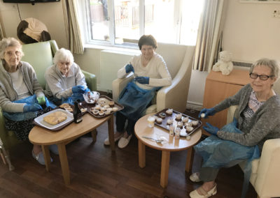 Residents at Lulworth House show off their cupcakes