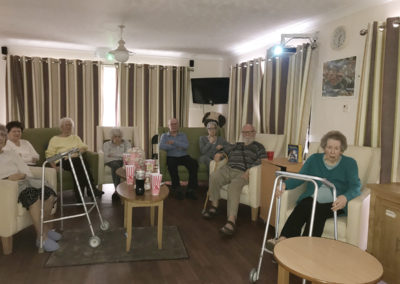 A group of Lulworth House residents enjoying a film night together