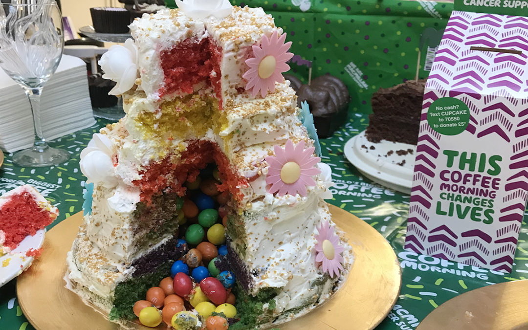 Lulworth House Residential Care Home create rainbow cake for Macmillan Coffee Morning
