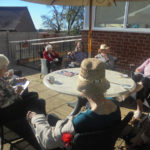 A group of residents sitting in the garden at the Old Downs Residential Care Home