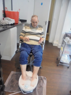 David from The Old Down Residential Care Home relaxing with his feet in a bubbly foot spa