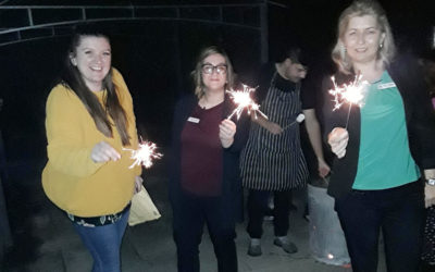 Staff and sparklers on bonfire night at Abbotsleigh Care Home