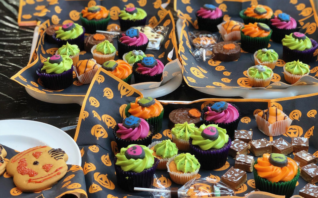A table of Halloween cupcakes and biscuits at Bromley Park Care Home
