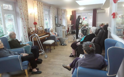 Saxophonist performing for the residents of Abbotsleigh Care Home