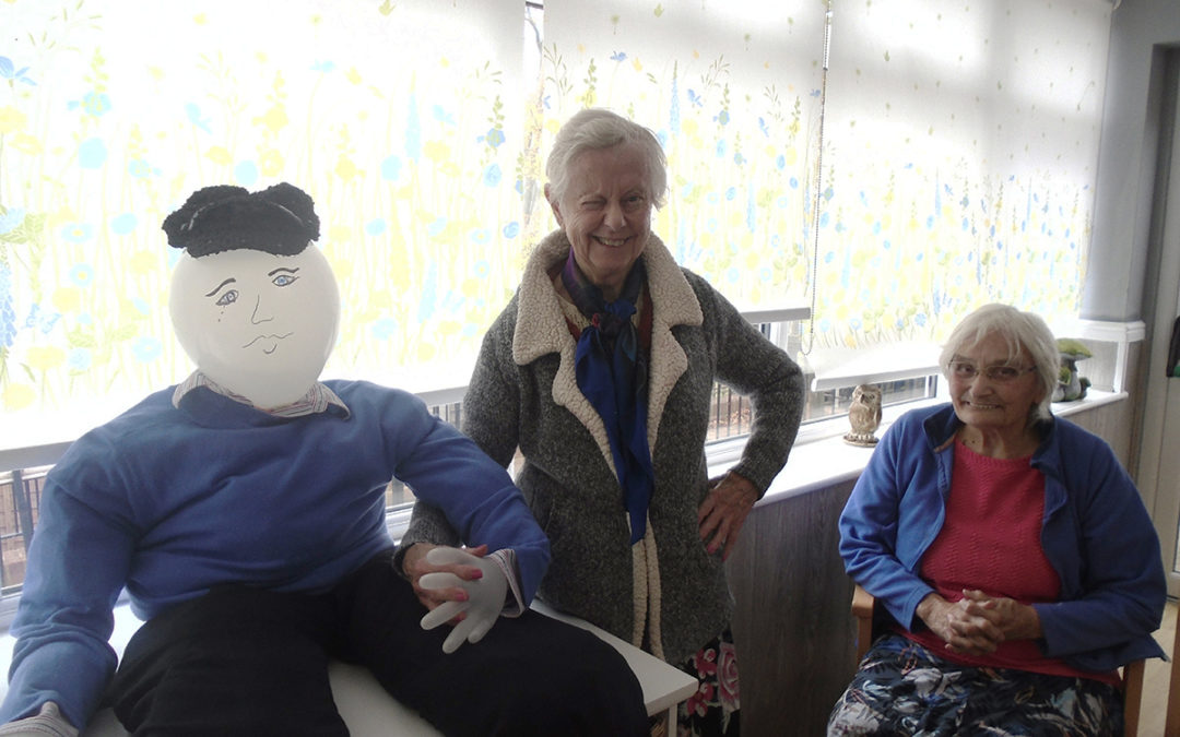 Ladies from The Olds Downs Residential Care Home showing off a balloon man they had made