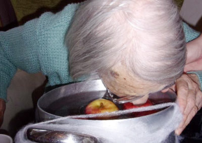 Loose Valley resident bobbing for apples at the Halloween party