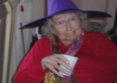 Loose Valley resident wearing a purple witch hat for Halloween