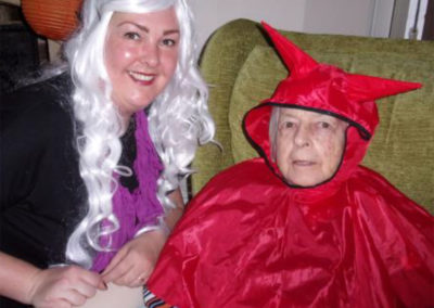 Loose Valley staff member and resident in devilish wigs and costumes for Halloween