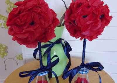 Bunches of handmade poppies from red tissue paper