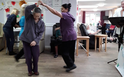 Abbotsleigh Care Home staff and residents dancing in the lounge together