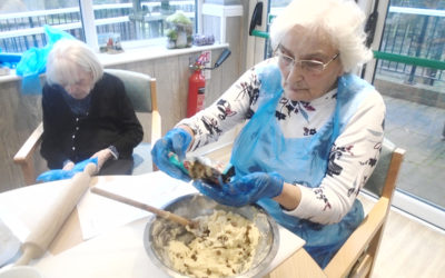Lady resident at The Old Downs Residential Care Home, preparing cookie ingredients in a bowl