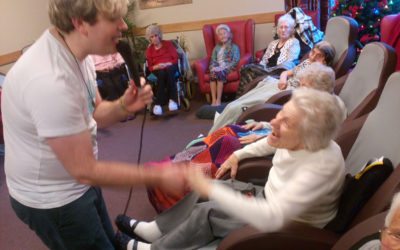 Singer Fred Clark singing to residents at Hengist Field Care Home