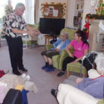 Mark the magician performing magic to residents at Loose Valley Care Home
