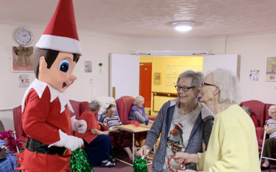 A cheeky giant elf entertaining residents at Lulworth House Residential Care Home