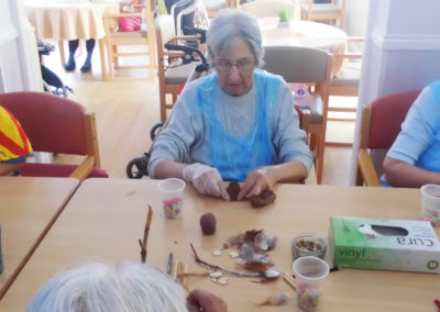 Woodstock residents making clay crafts with the children from Squirrel Nursery