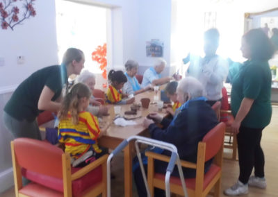 Woodstock residents making clay crafts with children from Squirrel Nursery