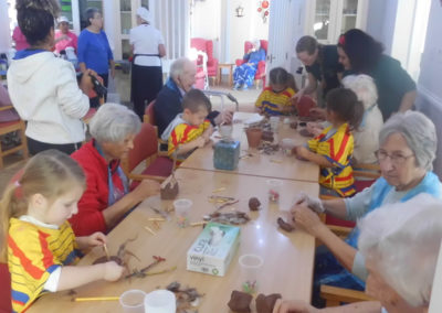 Woodstock residents and the children from Squirrel Nursery making clay crafts together