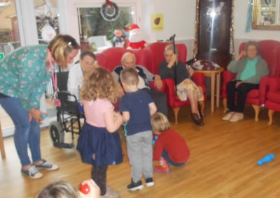 Young children from Rodmersham Nursery playing with residents from Woodstock Residential Care Home