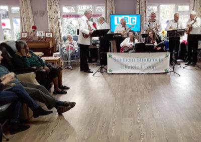 The Southern Strummers ukulele band performing at Abbotsleigh Care Home