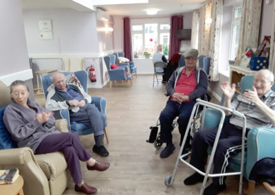 Residents at Abbotsleigh Care Home enjoying some live ukulele music