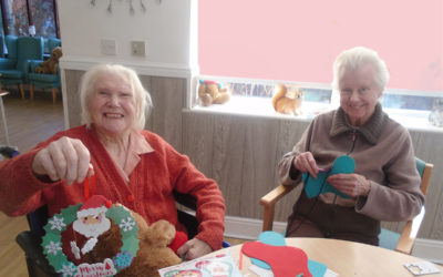 Ladies at The Old Downs displaying their festive handmade Christmas decorations
