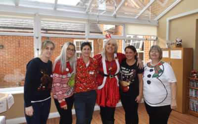The staff team at Princess Christian in Christmas jumpers and outfits