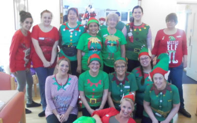 Woodstock Residential Care Home staff team dressed up Christmas elves costumes