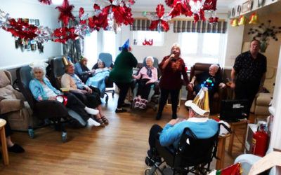 Meyer House Care Home residents enjoying a karaoke performance in their lounge