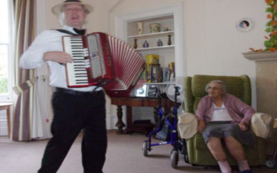 Accordionist Bing Lyle entertaining Loose Valley Care Home residents in their lounge